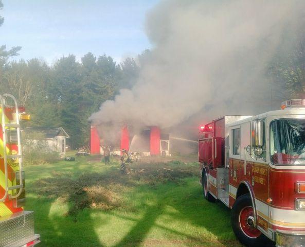 Passersby Spots Fire At Automotive Repair Shop